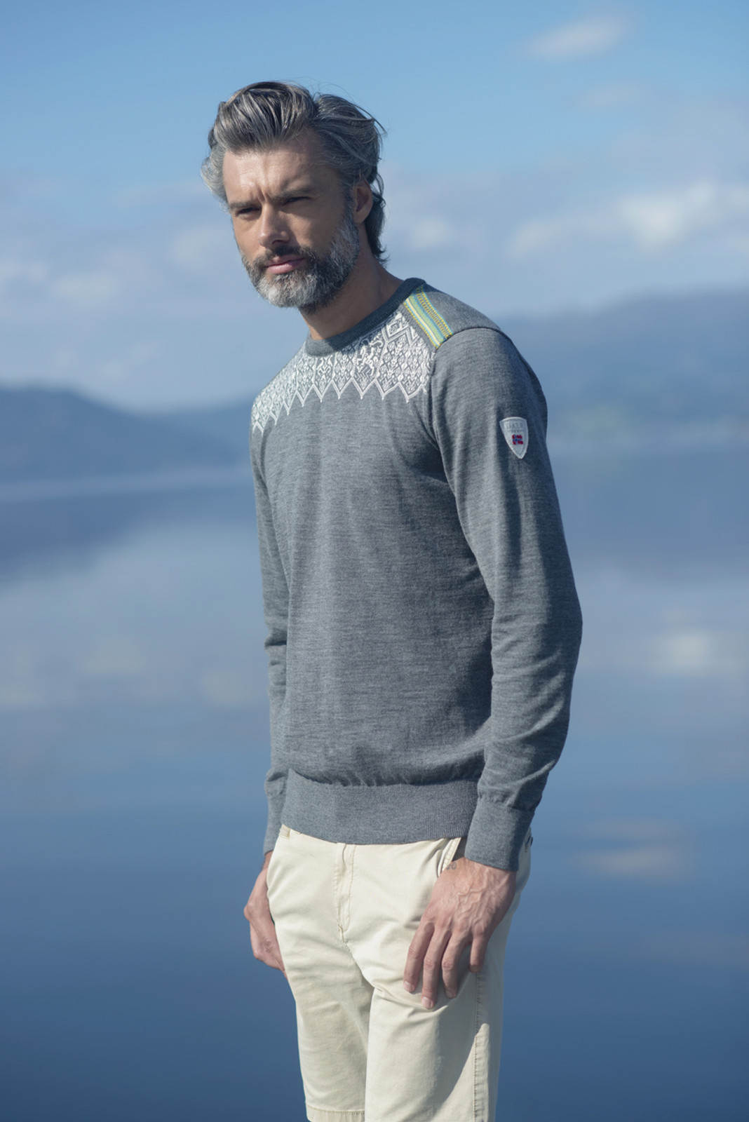 Man wearing Dale of Norway Men's Lillehammer Sweater in Smoke/Off White/Arctic Blue/Turquoise, 93271-E