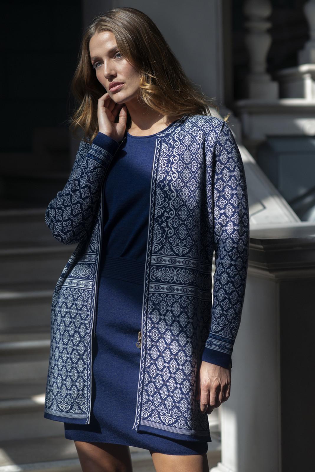 Woman wearing Dale of Norway Ladies' Ingeborg Cardigan, Electric Storm/Off White/Blue Shadow/Grau Vig, 83521-C