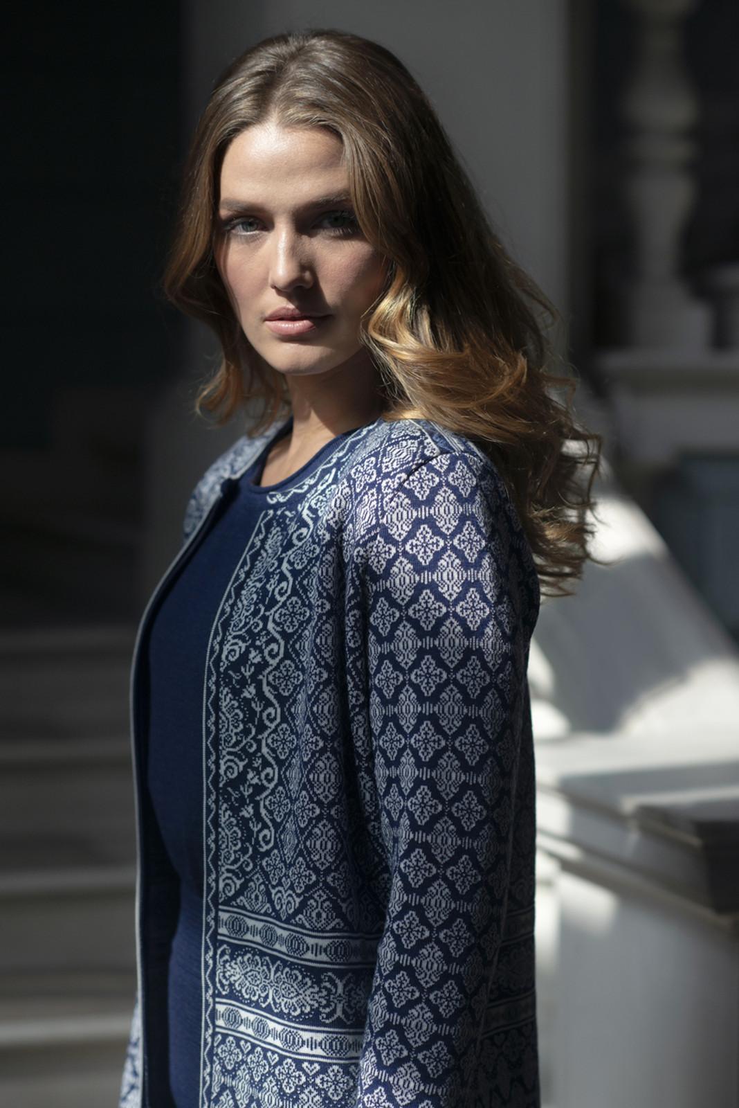 Closeup of woman wearing Dale of Norway Ladies' Ingeborg Cardigan, Electric Storm/Off White/Blue Shadow/Grau Vig, 83521-C