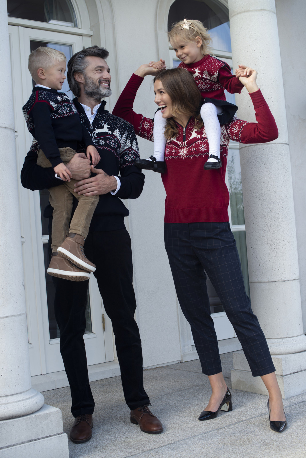 Family wearing Dale Christmas Sweaters 93921-B, 93931-C, 93941-B and 93941-C