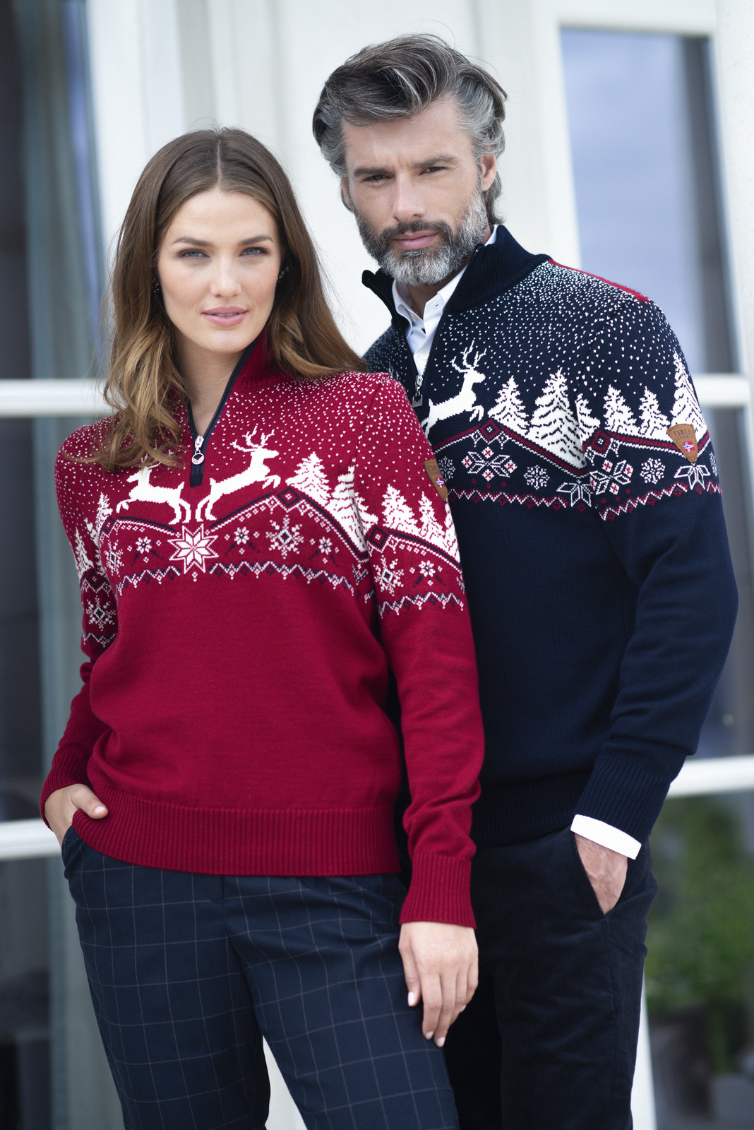 Couple wearing Dale Christmas Sweaters 93921-B and 93931-C
