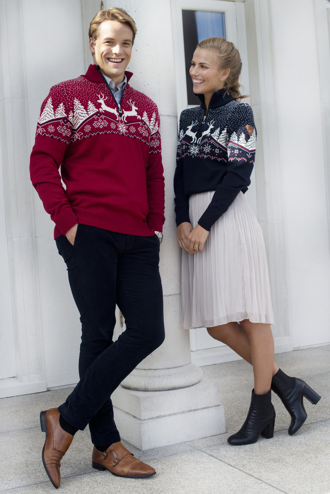 Couple wearing Dale of Norway Dale Christmas Sweaters 93921-C and 93931-B