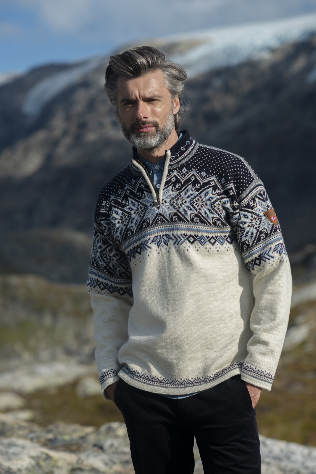 Man wearing Dale of Norway Vail Pullover - Off White/Smoke/Midnight Navy/Navy/Blue Shadow, 90331-A