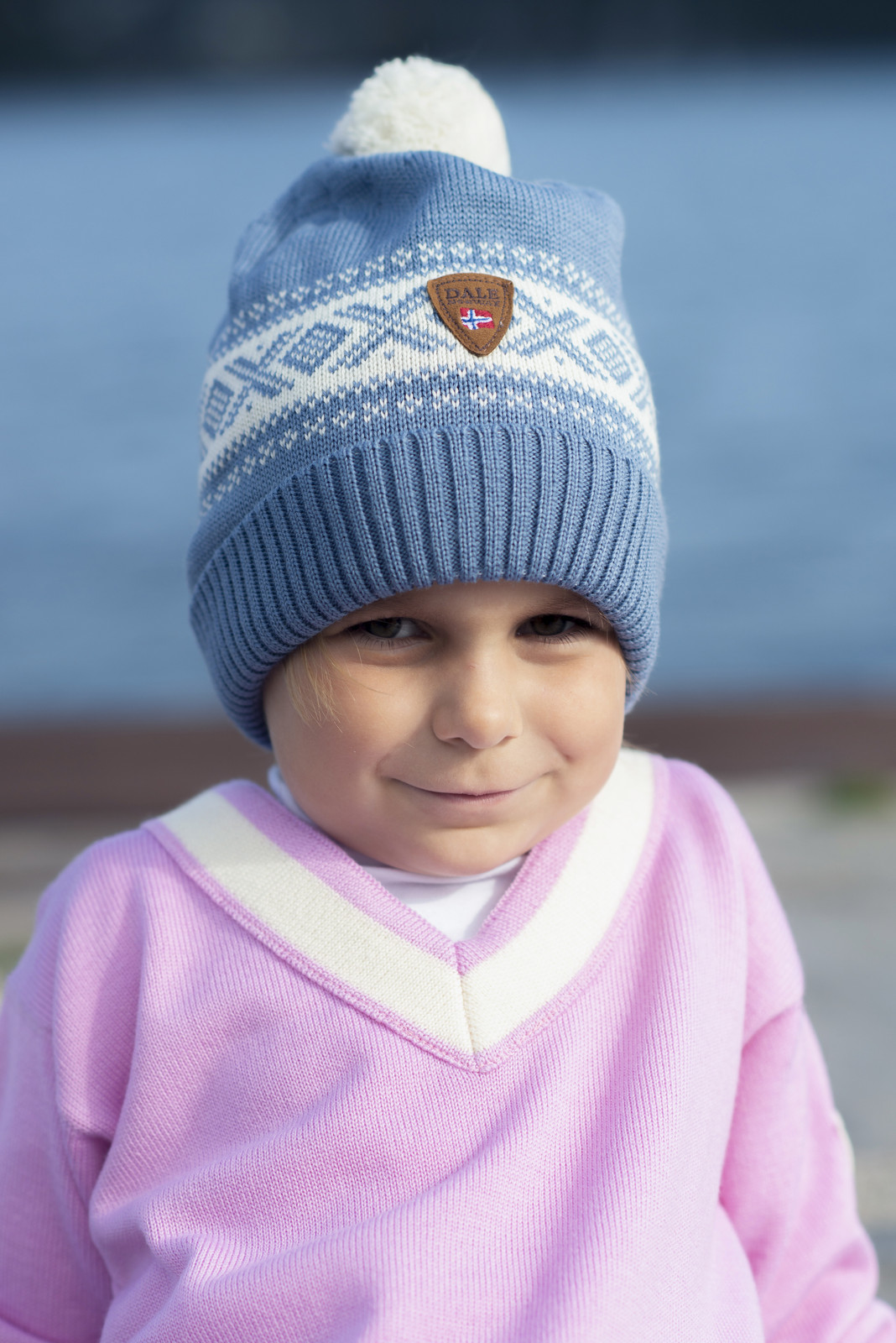 Girl wearing Dale of Norway Morgedal Sweater, Childrens - Pink Candy/Off White, 94031-I and Cortina hat