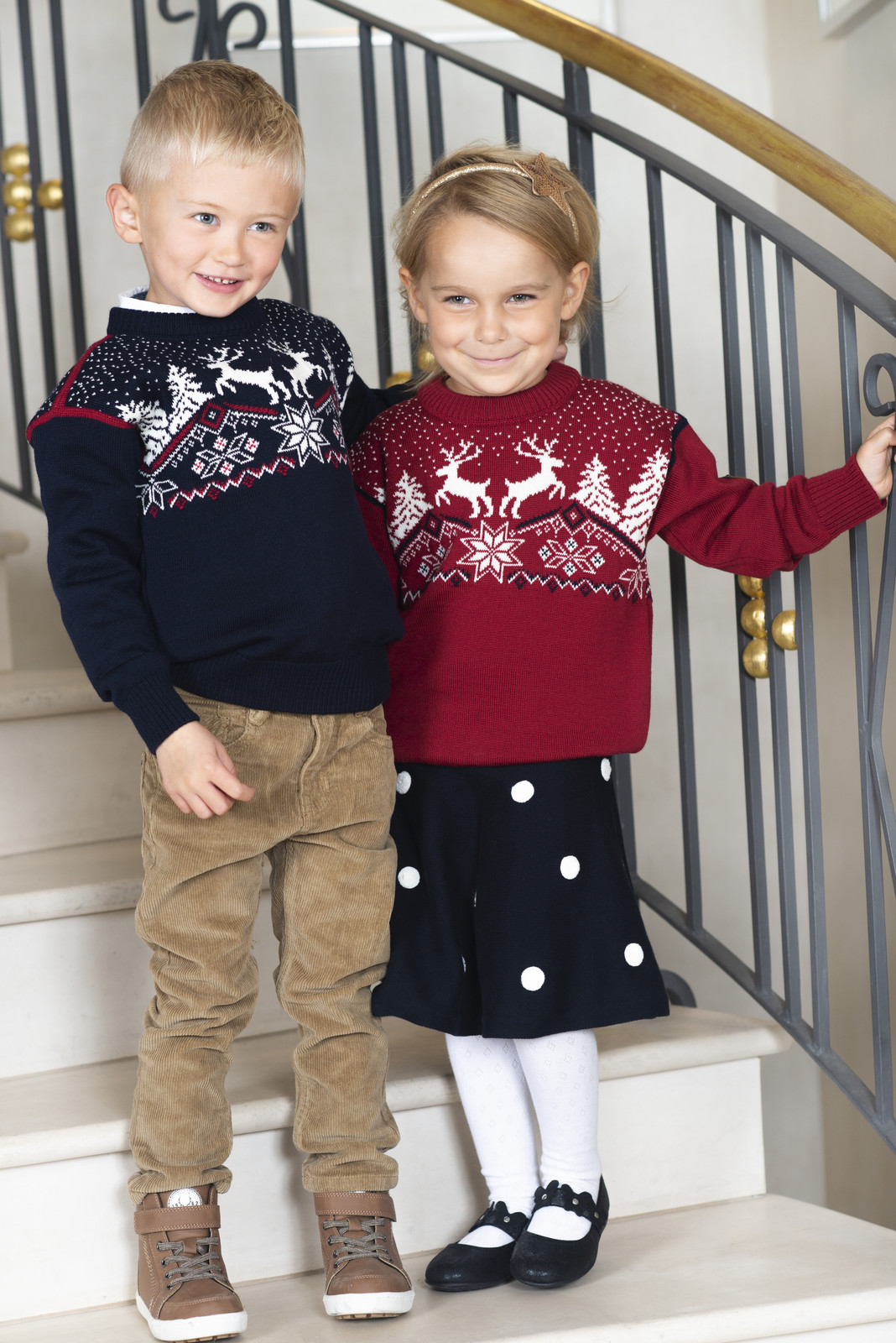 Kids wearing Dale of Norway Dale Christmas sweaters in Red Rose, 93941-B and Navy, 93941-C