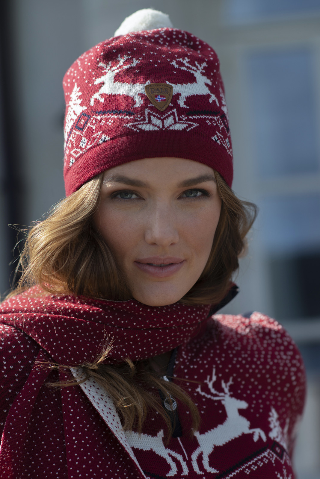 Woman wearing Dale of Norway Christmas Hat - Raspberry/Off White/Navy 48291-B