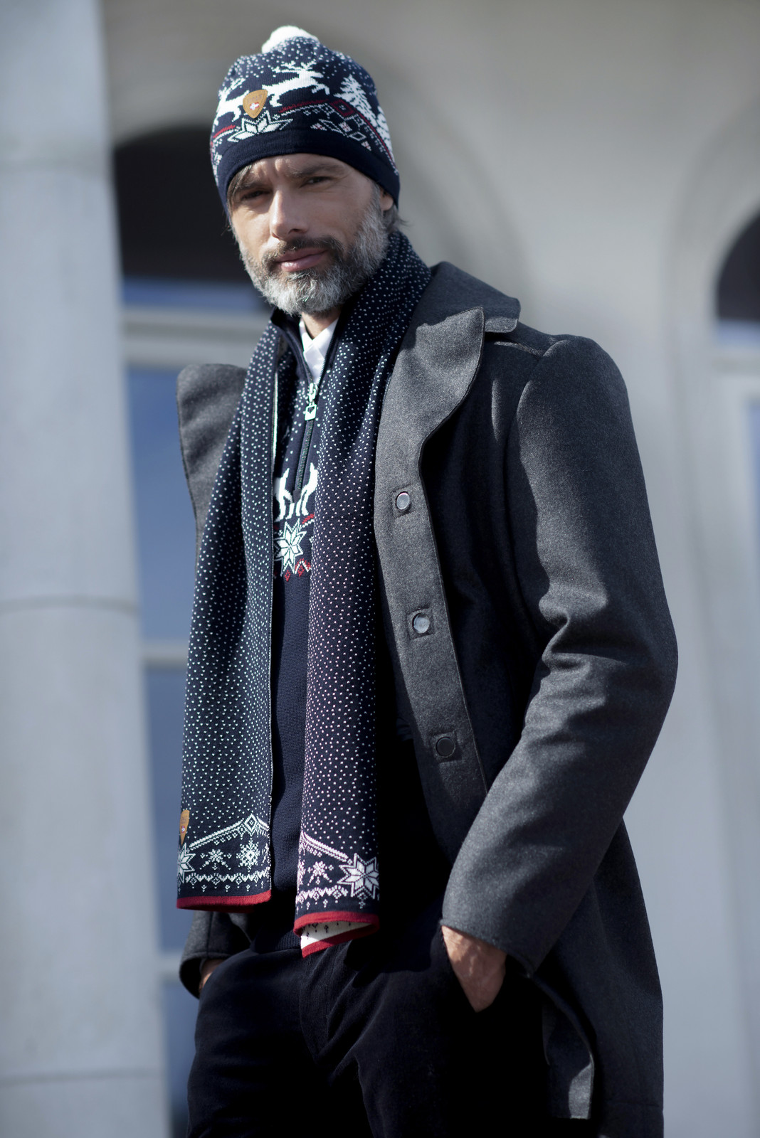 Man wearing Dale of Norway Dale Christmas Scarf - Navy/Off White/Raspberry, 11711-C
