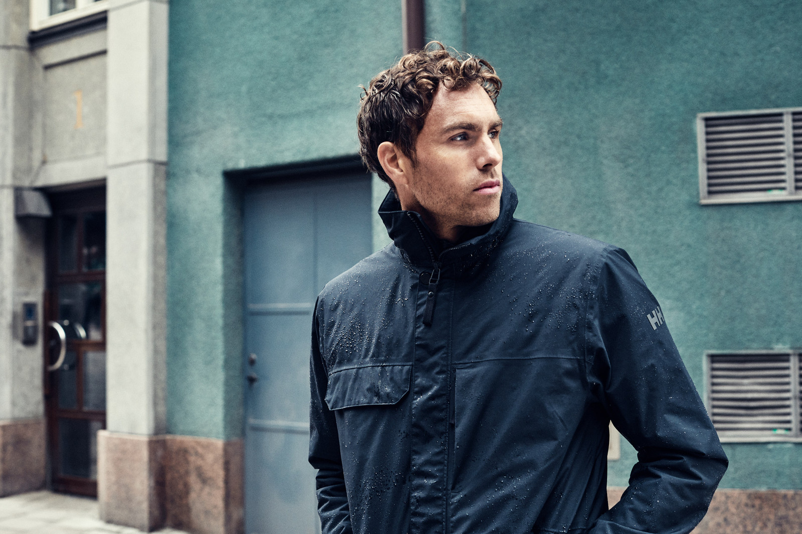 Helly Hansen Utility Rain Jacket, Men's - Black, 53415-990 on model urban lifestyle