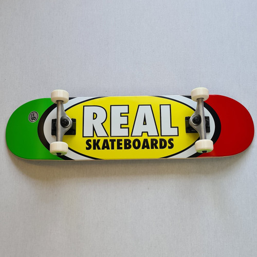 """REAL Skateboards  8.25"""" Team Edition Oval Complete Board - Yellow/Red/Green"""
