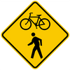diamond shape, yellow and black sign, features a bicycle and a pedrestrian