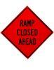 "diamond shape, orange and black sign, ""Road Closed Ahead"""