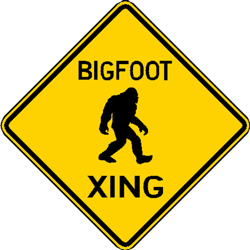black and yellow diamond shaped big foot crossing sign