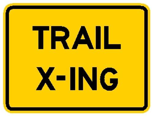 """rectangular, yellow sign, black words """"Trail X-ing"""""""