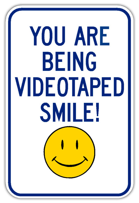 Surveillance Sign with Smiley Face
