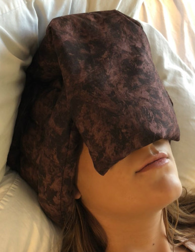 This has the neck going across the head & ears, with the basic applying gentle pressure on the forehead & face.