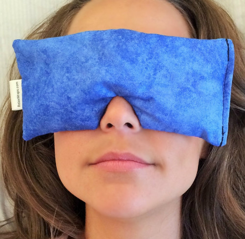 The Eye Wrap may be used directly over the eyes. It blocks out the light, providing a quick break from the world.