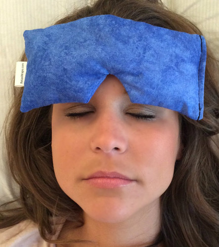 The Eye Wrap may be used across the forehead, relieving tension and relaxing a furrowed brow.