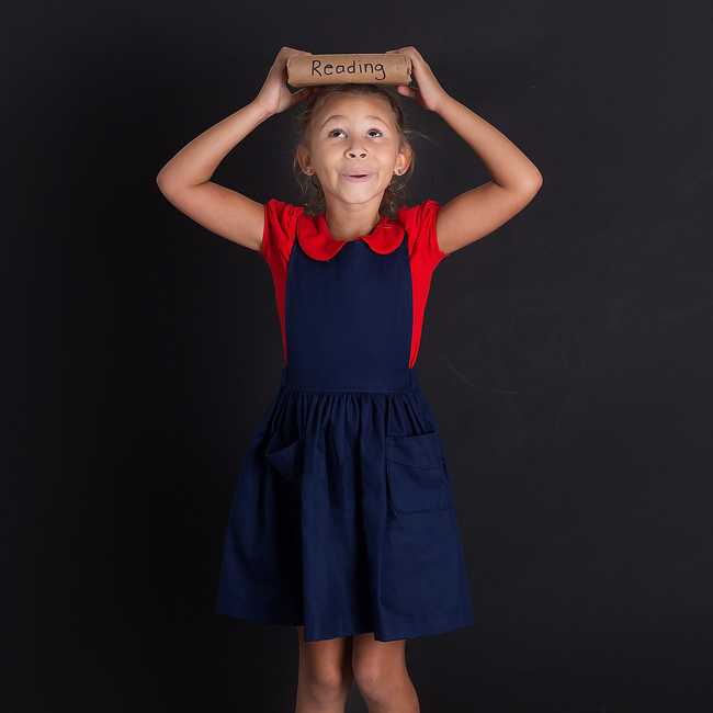 This timeless jumper is perfect for any school day! The skirt is made to be about 1/2 inch passed the knee and features pockets to save little notes, from friends or class! The straps have 3 adjustable levels so it can be shortened or lengthened as needed.   Available in Navy, Khaki Custom sizing available Designed and Made in the USA