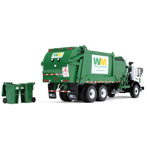 Mack TerraPro Waste Management With Heil Side Loader Back View