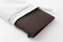 The brown leather cover arrives to you protected in a cloth cover to protect it from the elements.