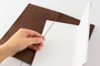 Traveler's Notebook, Regular, Leather Cover in brown. Kit comes with a blank notebook