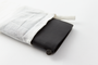 Housed in its muslin cover, the black passport travelers notebook is a lovely gift.
