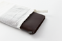 The Brown Leather passport Travelers Notebook comes in a muslin cloth case to protect it from the elements before it gets to you.
