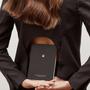 An Organised Life Zodiac Notebook Virgo being held behind woman's back