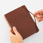 Midori Grain Brown Leather B6 Notebook has an elastic closure to keep your notes safe