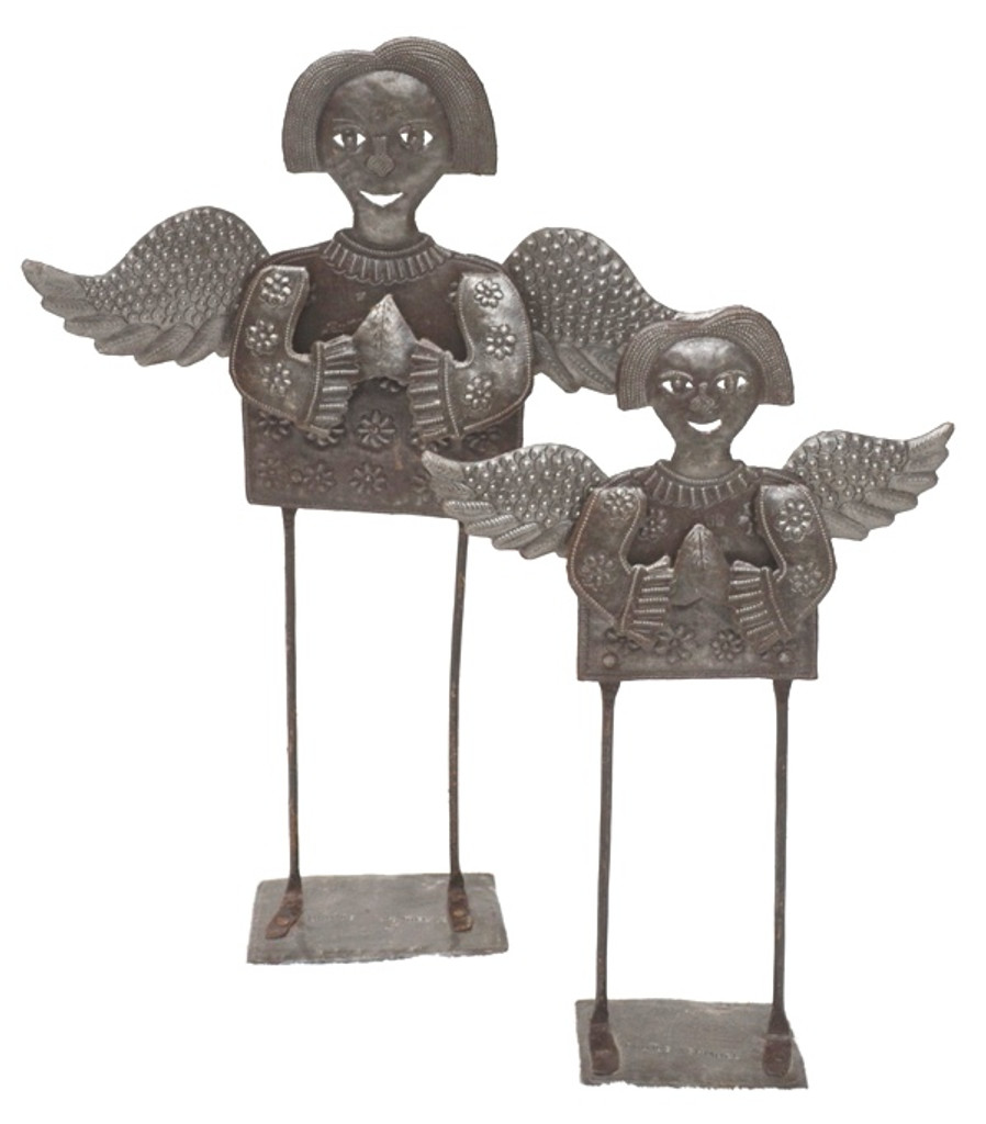 An angel for your table, your mantle, or even your garden! This versatile little gal will bring holiday cheer no matter where she is placed. Arrange some greenery at her feet and add some berries or bells for color. Let your imagination go! Made from recycled metal entirely by hand in Haiti.