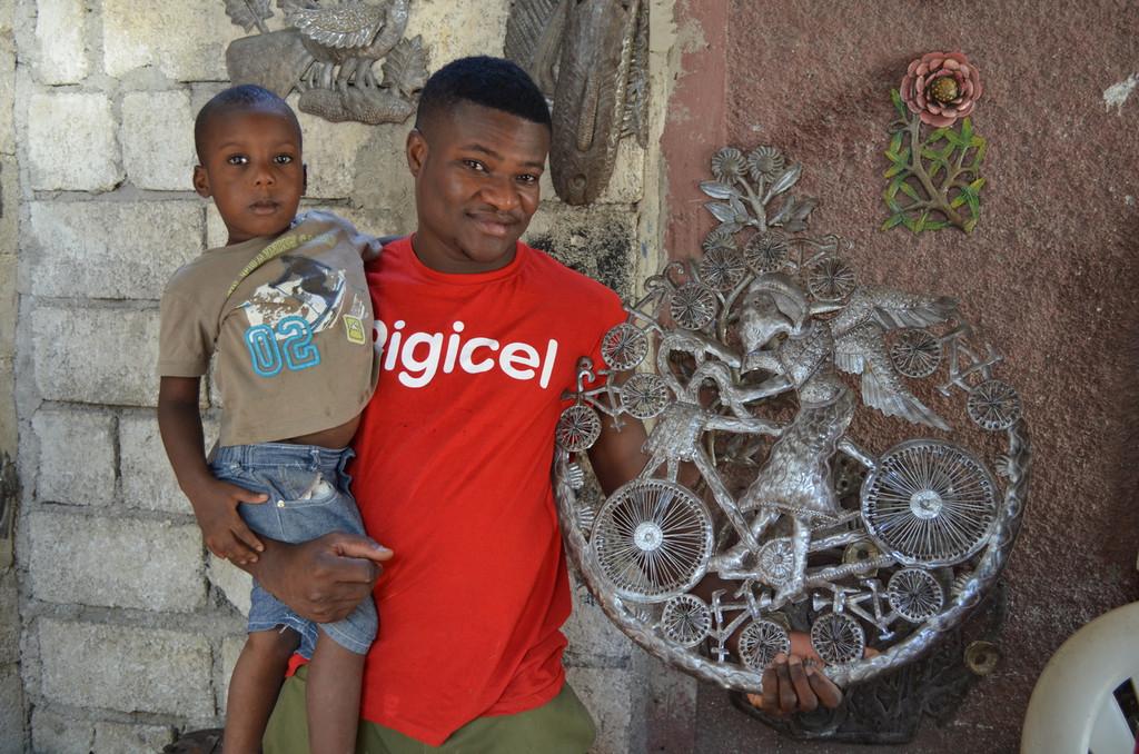 Hand made metal sculpture Haiti Metal art - boy on bike