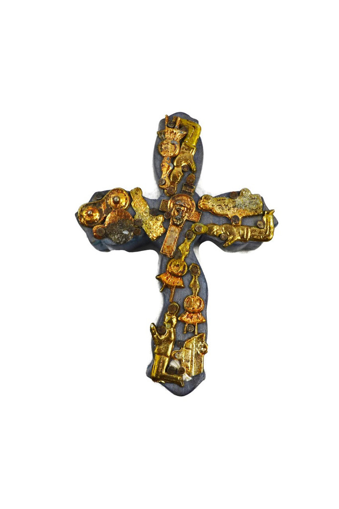 small wooden cross with milagro hearts