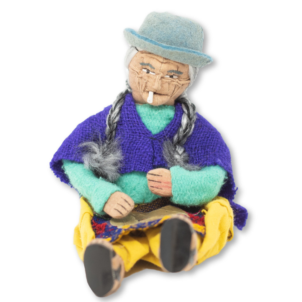 Traditionally Dressed Ethnic Doll from Bolivia, Smoking a cigarette and selling Coco leaves