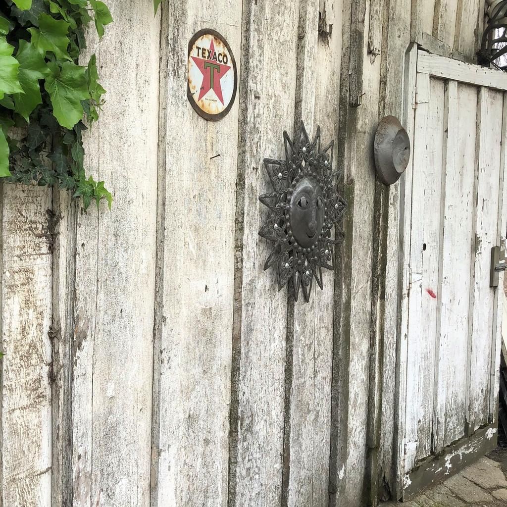 Sun side of a barn, wall art Haiti