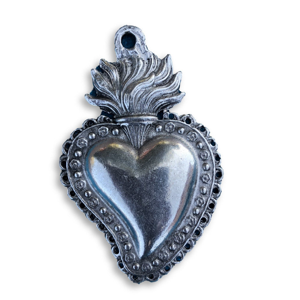 A heart stands for love, relationship, and commitment. A flaming heart specifically represents passion for something or someone.