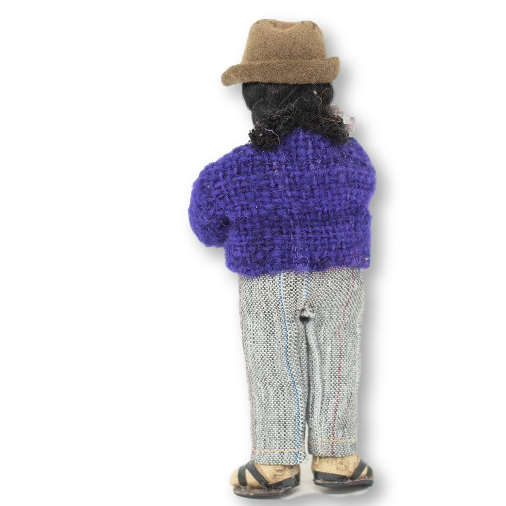 "Bolivian man playing Siku in a Purple Wool Sweater, Panpipes  5"" x 2"" x 1.5"""
