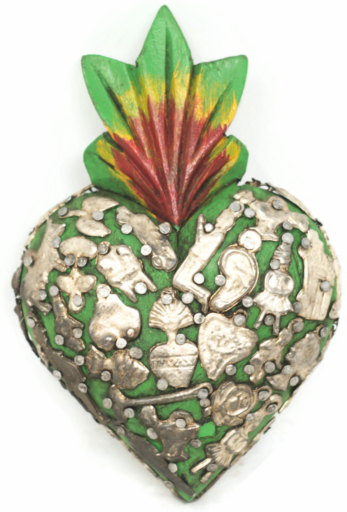 This heart was carved from wood topped by a red-yellow with a green base the flame that symbolizes the Sacred Heart.