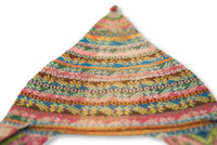 This vintage Andean Peruvian Bolivian ch'ullo colorful alpaca wool knit ear-flap folk hat dates from the mid 20th century.