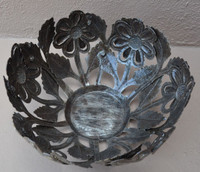 Inside look at metal sunflower bowl from haiti