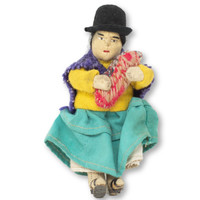Cholita fashion is comprised of a colorful pleated skirt worn over layers of petticoats, an embroidered shawl held by a brooch, and a small bowler hat