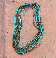 Multi Strand Choker Necklace made of glass beads that have been hand loomed by women artisans in the Lake Atitland region Guatemala. Pair with a strapless dress or under a collared blouse!