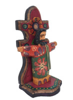 side view of mini Jesus on shelf hand carved in Guatemala