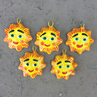 smiling suns painted by hand in Guatemala