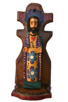 Kiln-dried wood is shaped using basic hand tools and Machetes; then family members paint the bright designs.