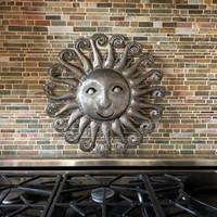 over the stove metal wall decor, sun