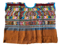 This huipil is beautiful with its blue, and brown that features the traditional animal motifs found in the huipiles of San Juan Comalapa. The colors of the figures are pink, white, blue, teals, and maroon. The collar and sleeve openings are trimmed in blue.