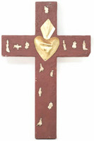 Milagros, or tiny miracles, are small religious charms that have been used for hundreds of years to petition saints for guidance, help and protection. The cross is made of wood and it's covered in small milagros.