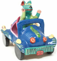 Authentic Mexican folk art by artist Gerardo Ortega of Jalisco.  This is a happy dog driving a fancy bright blue car in the Barro Betus technique.