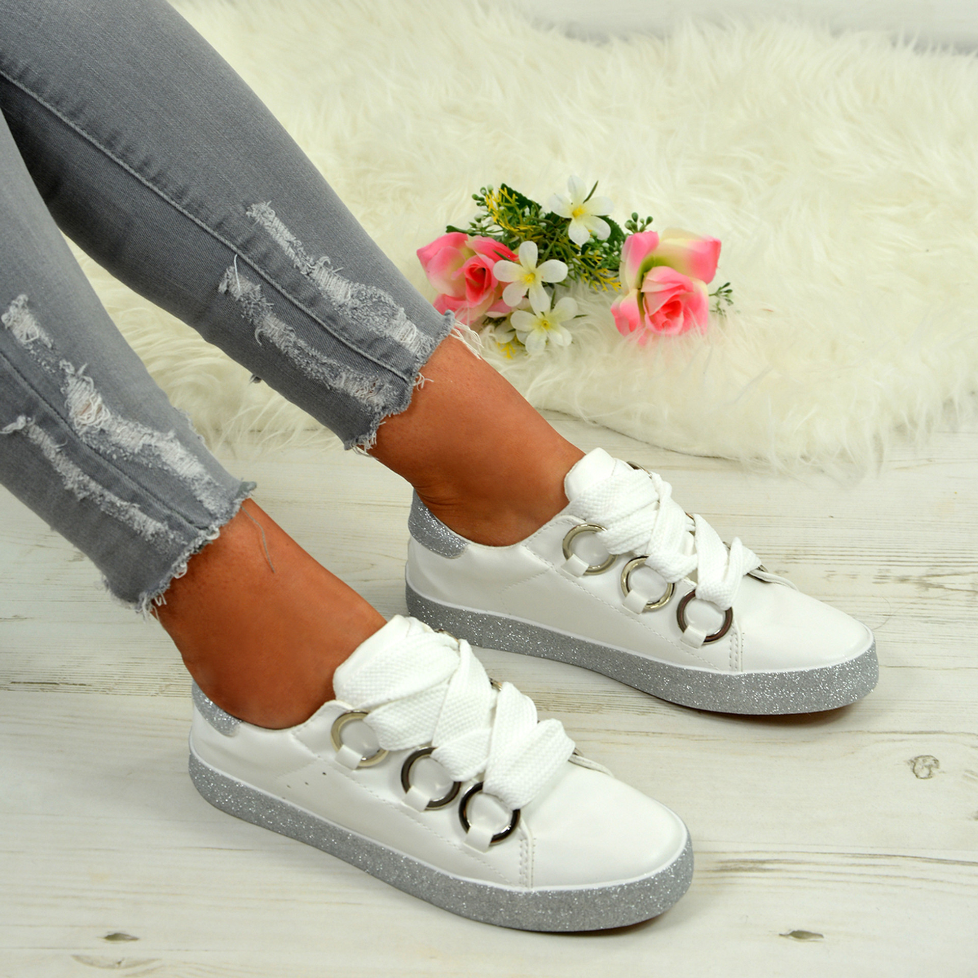 Brittany White with Silver Trainers