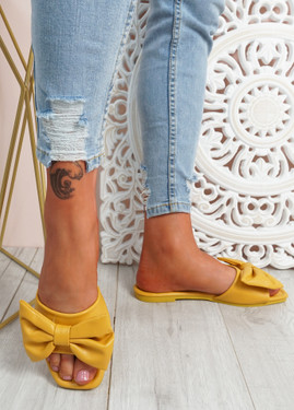 Nito Yellow Bow Flat Sandals